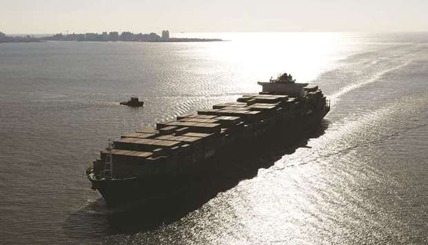 A container ship sails into New York Harbor (file).