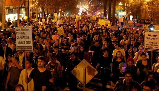 Demonstrators march on Market Street in San Francisco following the election of Donald Trump