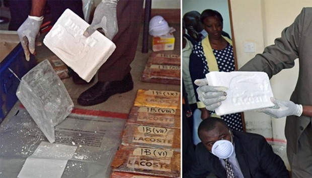An official presents a slab of cocaine as evidence