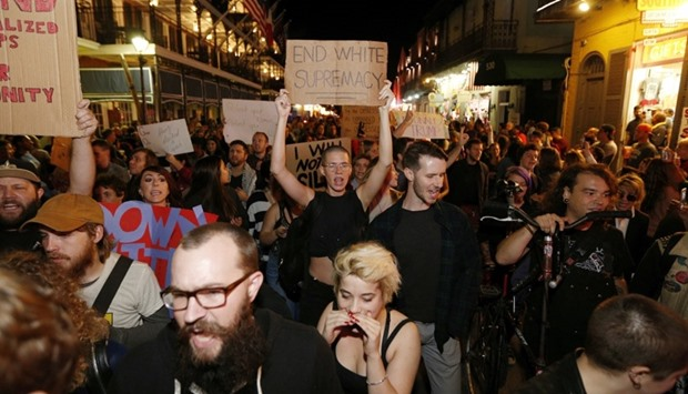 Protesters make their way down Bourbon St. as they demonstrate against the election of Donald trump