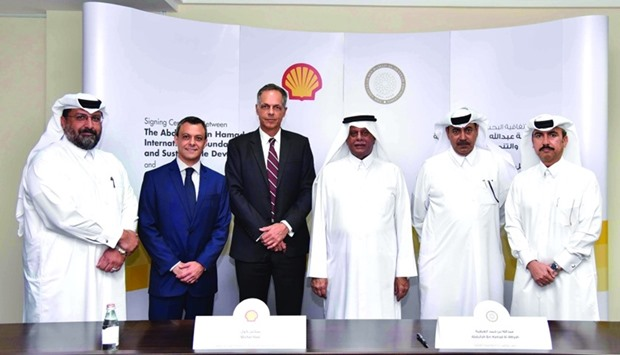 HE al-Attiyah, Kool among other executives at the agreement signing.