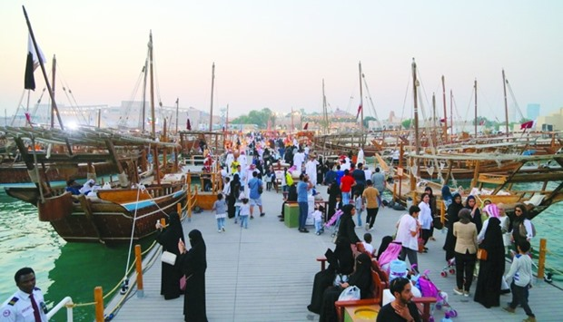 A view of the berthed dhows and visitors at Katara beach