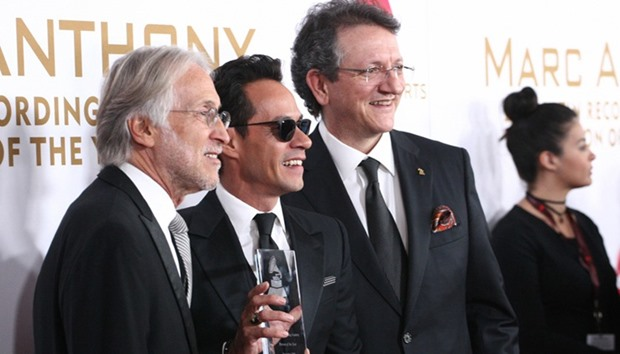 (L-R) Neil Portnow, president and CEO of the Recording Academy, Singer Marc Anthony, and Gabriel Aba