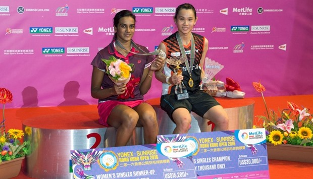 Winner Tai Tzu-ying of Taiwan (R) poses with second-placed P.V. Sindhu of India
