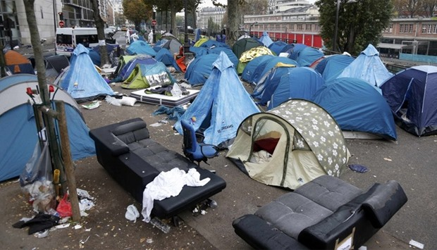 the tents of dismantled makeshift camp in a street near Stalingrad metro station in Paris
