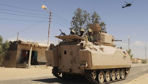 Egyptian army soldiers patrol in northern Sinai.