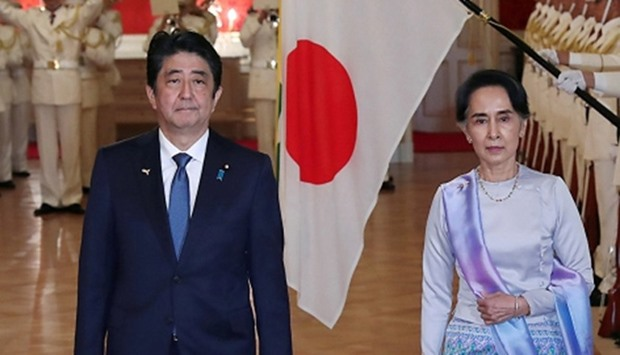 Myanmar State Counselor Aung San Suu Kyi with Japan's Prime Minister Shinzo Abe