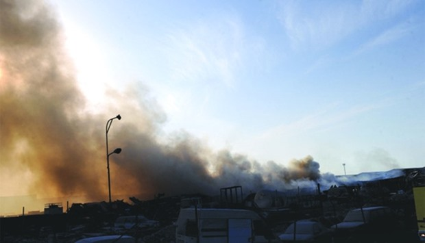 Heavy smoke is seen from the area which witnessed a fire. PICTURES: Shemeer Rasheed.