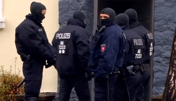 German special police forces raiding a house