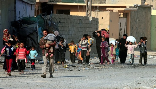Displaced people who fled the violence of Islamic State militants in Mosul