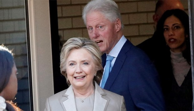 Hillary Clinton and her husband former Bill Clinton depart after voting in the US presidential elect