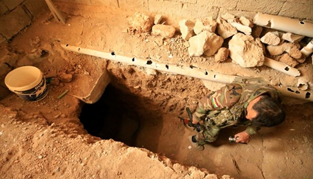 Peshmerga forces inspects a tunnel used by Islamic State militants