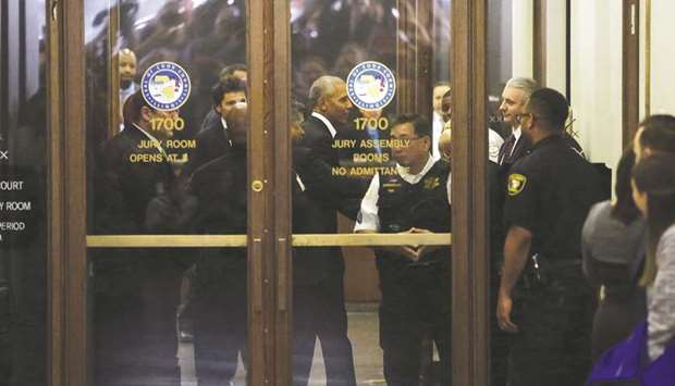 Obama arrives for Cook County jury duty at the Daley Centre in Chicago, Illinois.
