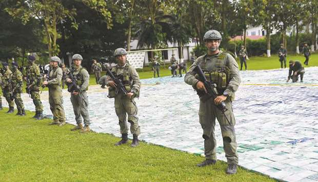 This handout picture released by Colombia's presidency shows anti-narcotics police guarding over 12