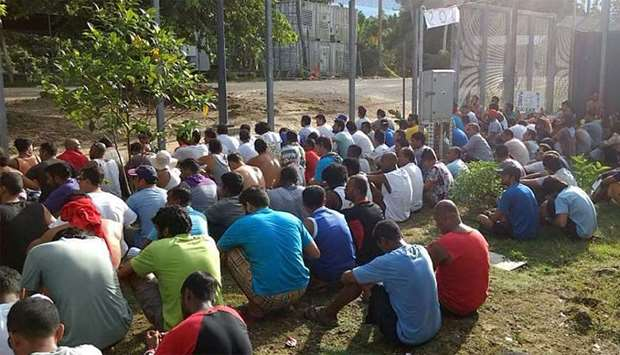 Detainees staging a silent protest inside the compound at the Manus Island detention centre in Papua