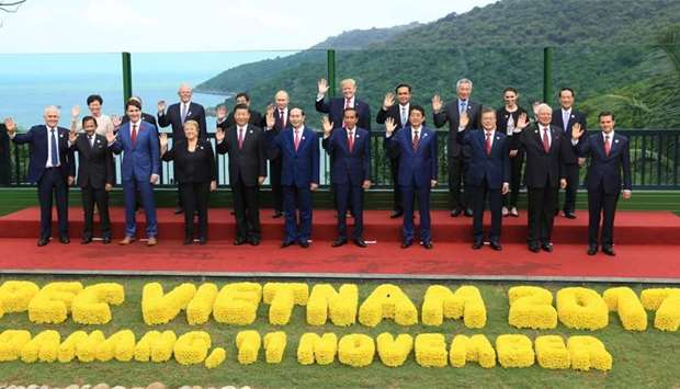 Leaders pose during the Asia-Pacific Economic Cooperation (APEC) leaders' summit