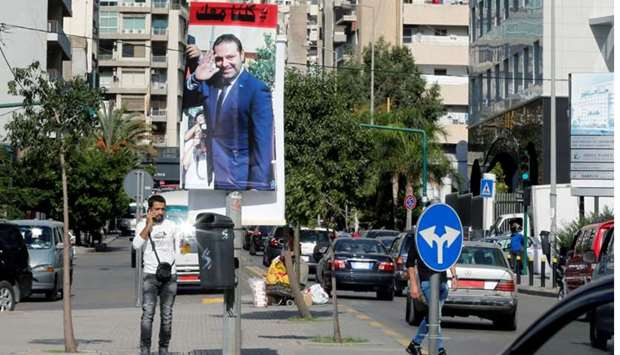 A poster depicting Lebanon's Prime Minister Saad al-Hariri, who has resigned from his post, is seen