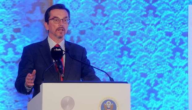 Charges d'affaires William Grant of the US embassy in Qatar delivers a speech during the forum.