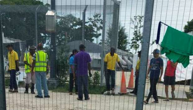 Workers dismantle structures in Lombrum detention camp on Manus island, Papua New Guinea