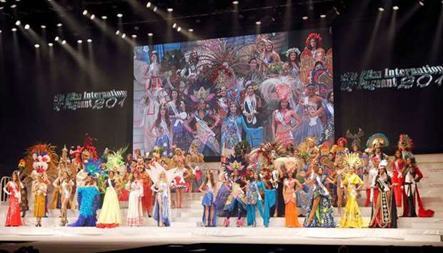 Contestants wearing national costumes pose at the 57th Miss International Beauty Pageant in Tokyo, J