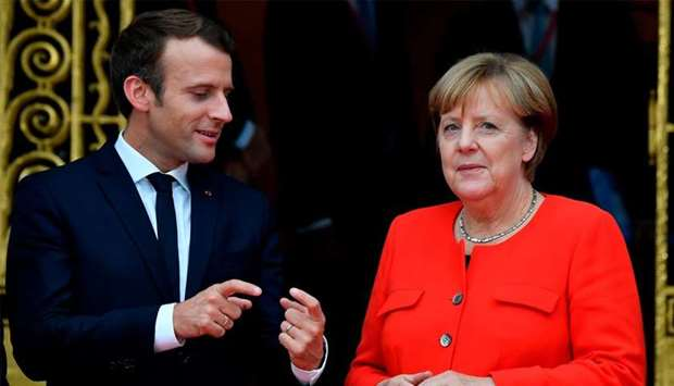 French President Emmanuel Macron with German Chancellor Angela Merkel