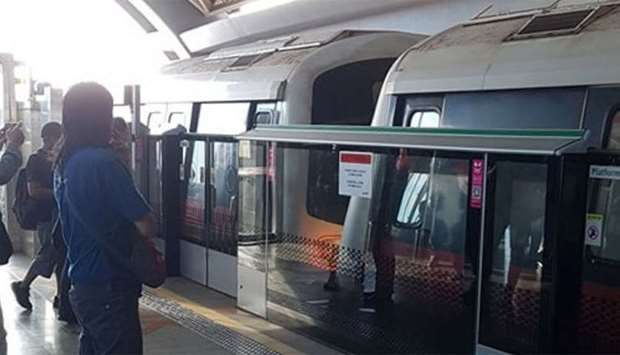 People look after a mass transit train collision at a platform at Joo Koon station in Singapore