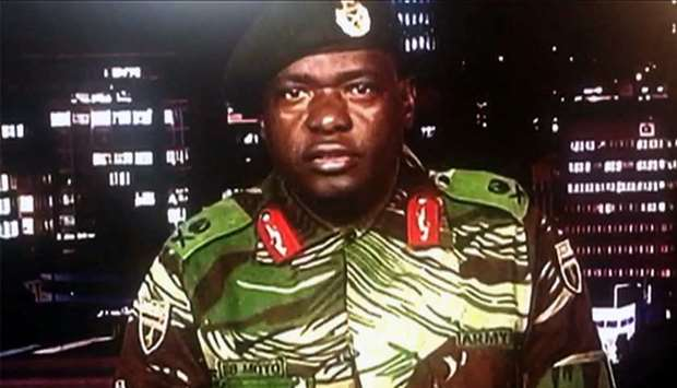 Zimbabwe Broadcasting corporation shows Zimbabwe Major General Sibusiso Moyo reading a statement at