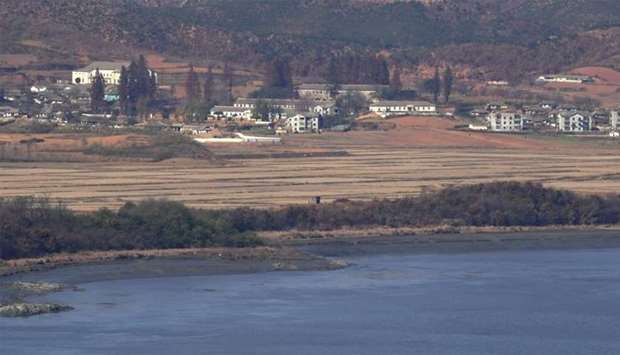 A North Korean guard post (C) in the border county of Kaepoong