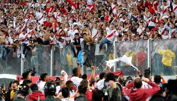 Peruvian players celebrate after defeating New Zealand by 2-0 and qualifying for the 2018 football W