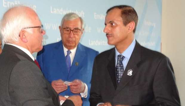 Hussein Alfardan and Sheikh Dr Khalid with German Federal Minister of State Peter Plesser