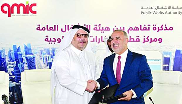 Ashghal president and senior engineer Saad bin Ahmed al-Muhannadi (left) and QMIC executive director