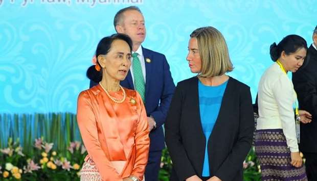 Myanmar's State Councellor and Foreign Minister Aung San Suu Kyi (L) speaks with EU Foreign Policy R