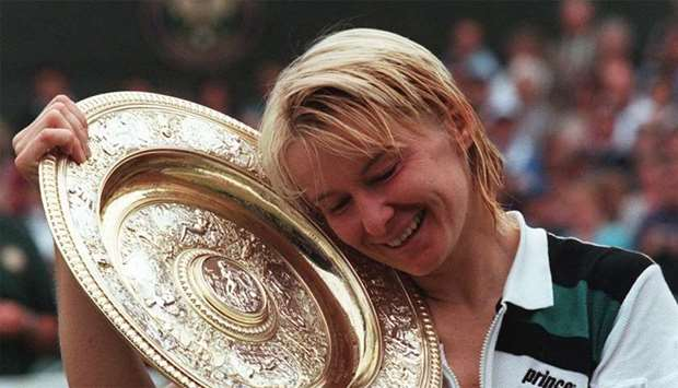 Czech Republic's Jana Novotna enjoying her championship trophy after winning the final of the women'