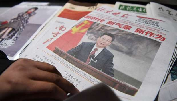 A newspaper featuring Chinese President Xi Jinping at a news stand