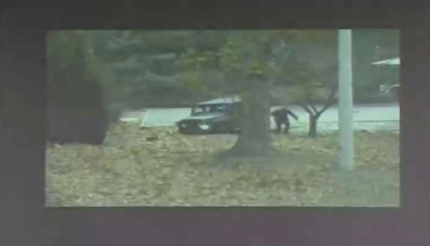 A CCTV footage shows a North Korean soldier running from a vehicle during a United Nations Command (