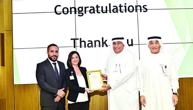 Ashghal officials receiving ISO 9001:2015 certification from officials of Afnor Groupe