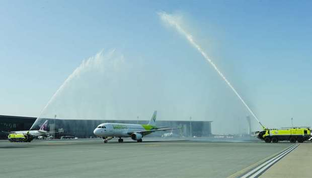 SalamAir's inaugural flight from Muscat receiving a water salute on its arrival at the Hamad Interna