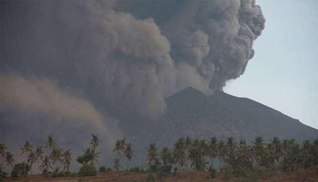 Mount Agung volcano erupts, as seen from Culik Village, Karangasem, Bali, Indonesia