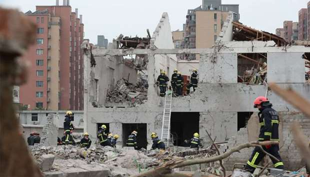 Rescue workers are seen at the site of an explosion in Ningbo, China's eastern Zhejiang province