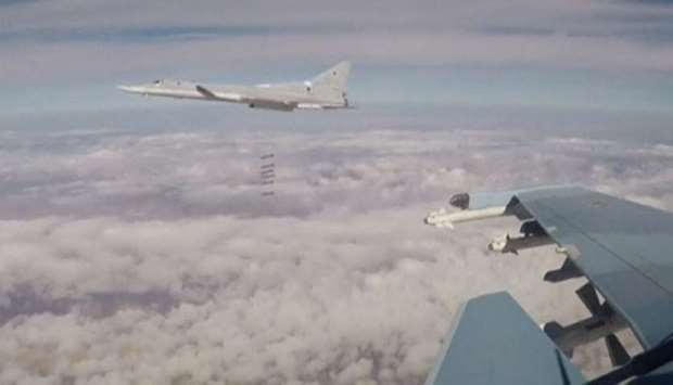 Russian long-range bombers hit Islamic State targets in the northeast of Syria, in this still image