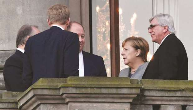 Merkel and other leaders of her Christian Democratic Union (CDU) party are seen yesterday during a b