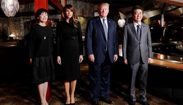 US President Donald Trump and his wife Melania Trump are welcomed by Japan's Prime Minister Shinzo A