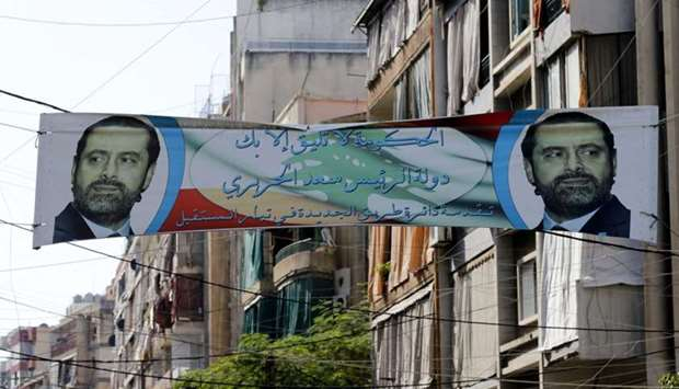 A banner bearing a portrait of Lebanese Prime Minister Saad Hariri in the capital Beirut a day follo