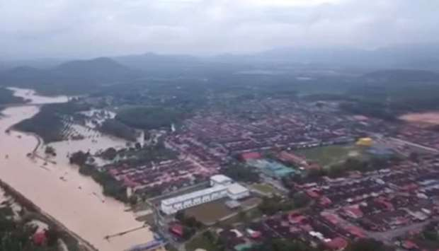 An aerial view shows the banks of a river overflowed after floodwater rose for more than 24 hours of