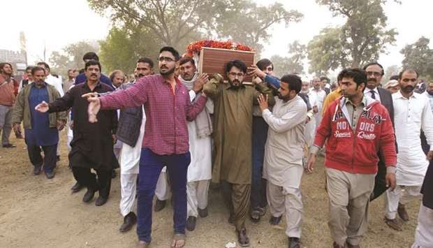 Friends, colleagues and relatives carry the coffin of Pakistani consular official Nayyar Iqbal Rana,