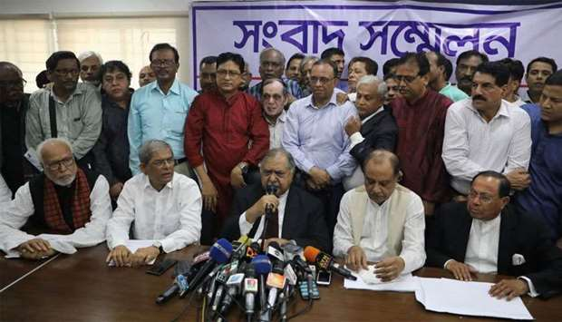 Members of Jatiya Oikyafront, an opposition alliance, hold a news conference at the National Press C