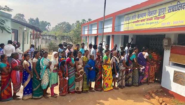 Indian voters line up to vote at a polling station in Sukma in Chhattisgarh state