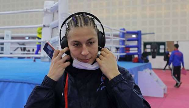 France's Mona Mestiaen removes a mask after her practice session ahead of AIBA Women's World Boxing