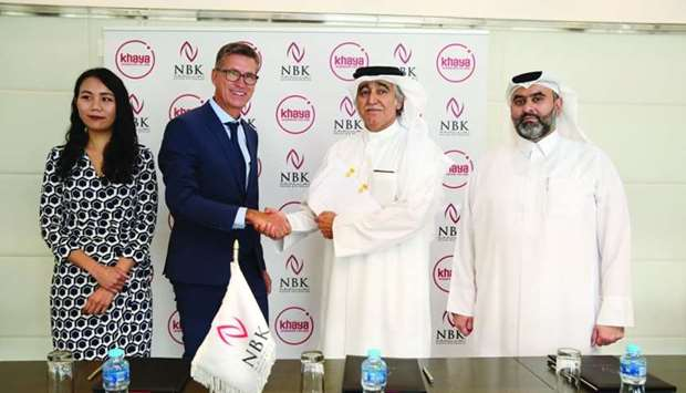 NBK Holding and Khaya Global officials