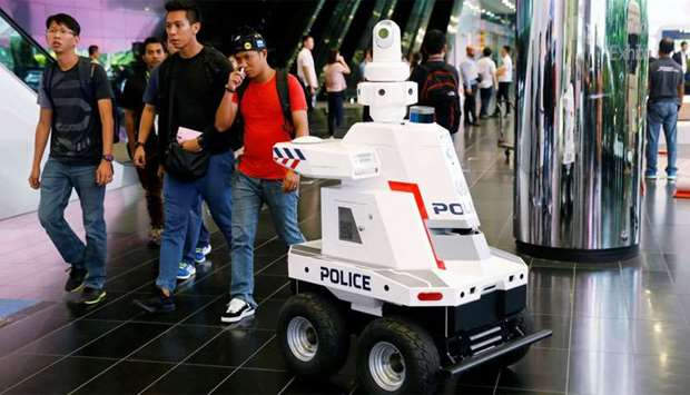 A police surveillance robot patrols the lobby of Suntec Convention Center during the ASEAN Summit in